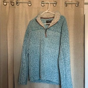 True Grit Turquoise colored pullover.
